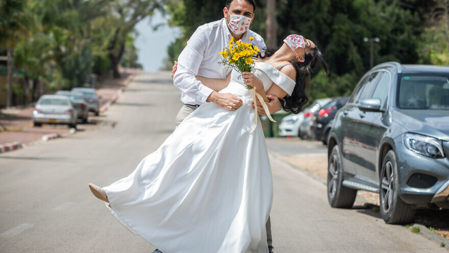 Gal Sade Knigsfild and Nofar Almakias before their wedding in Moshav Yashresh after their original plans were canceled due to new regulations following the spread of the coronavirus, on April 6, 2020. Photo by Yossi Aloni/Flash90.