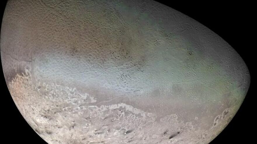 """A global color mosaic of Neptune's moon Triton, taken in 1989 by """"Voyager 2"""" during its flyby of the Neptune system. Credit: NASA/JPL/USGS."""