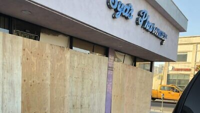The boarded-up exterior of Syd's Pharmacy in Los Angeles, vandalized on May 30, 2020, during nationwide protests that followed in the wake of the death of African-American George Floyd in police custody in Minneapolis on May 25. Credit: Courtesy.