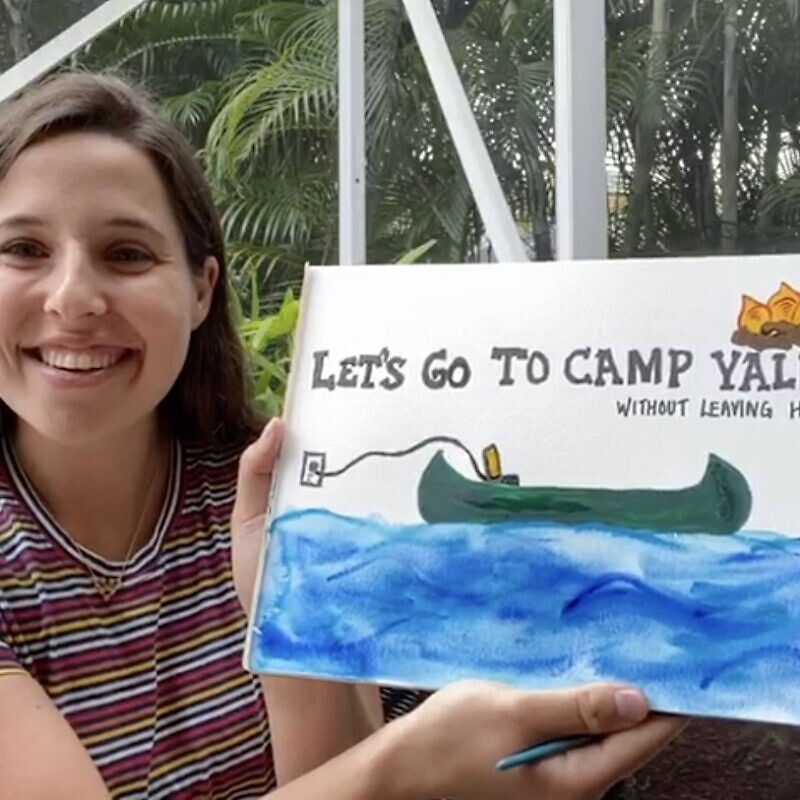 Mariel Falk, co-founder and co-director, showing off her painting skills and Camp Yalla enthusiasm. Source: Screenshot.