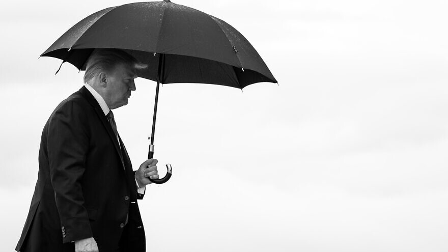 U.S. President Donald Trump carries an umbrella as he walks from Marine One to board Air Force One at Joint Base Andrews, Md., on June 20, 2020, en route to Tulsa, Okla. Credit: Tia Dufour/The White House.
