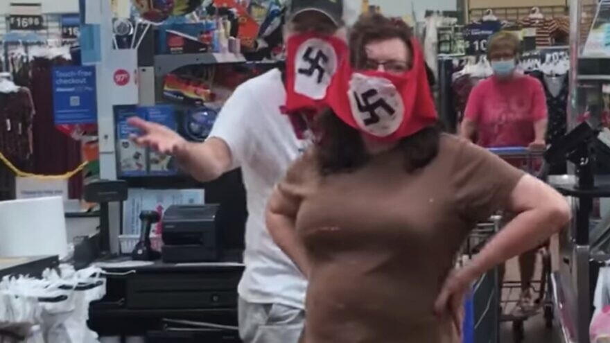 A couple was confronted at a Walmart in Marshall, Minn., on July 25, 2020, for wearing Nazi flag face masks. Credit: Raphaela Mueller/Facebook.