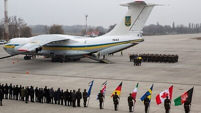 A ceremony at Ukraine's Boryspil International Airport commemorating the 176 people who died when Ukraine International Airlines Flight 752 was shot down on Jan. 8 after taking off from Tehran Imam Khomeini International Airport, Jan. 19, 2020, Credit: Office of the President of Ukraine via Wikimedia Commons.