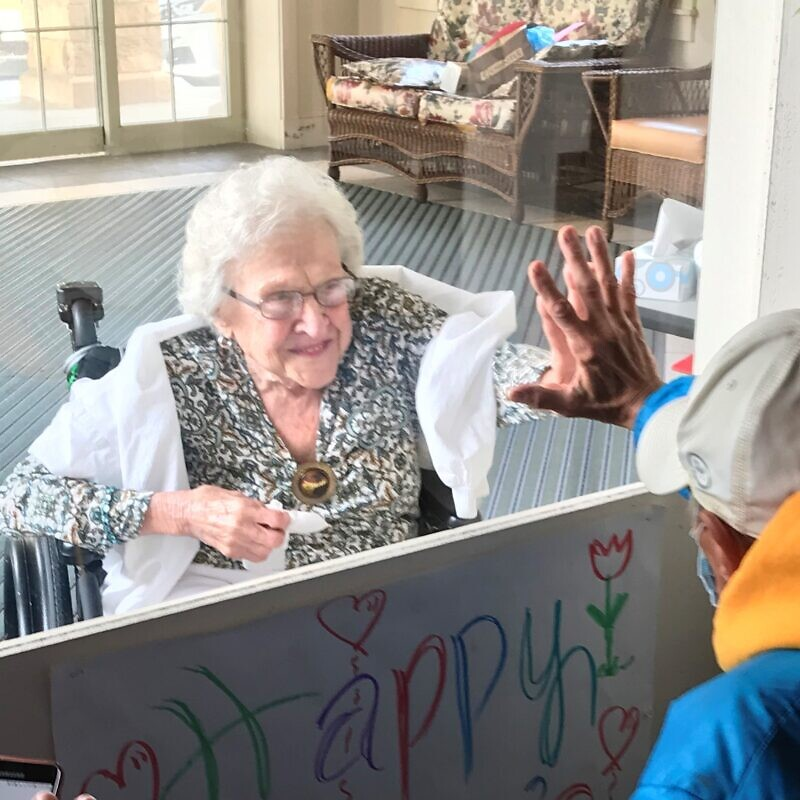 A family visits an elderly resident at a senior facility run by the Jewish Association on Aging in Pittsburgh. Credit: Courtesy.