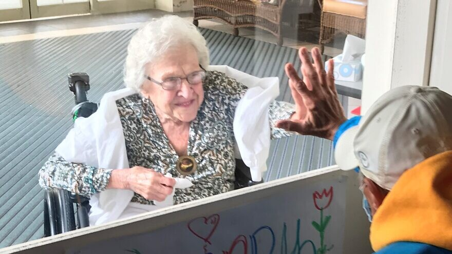 A family member visits an elderly resident at a senior facility run by the Jewish Association on Aging in Pittsburgh. Credit: Courtesy.