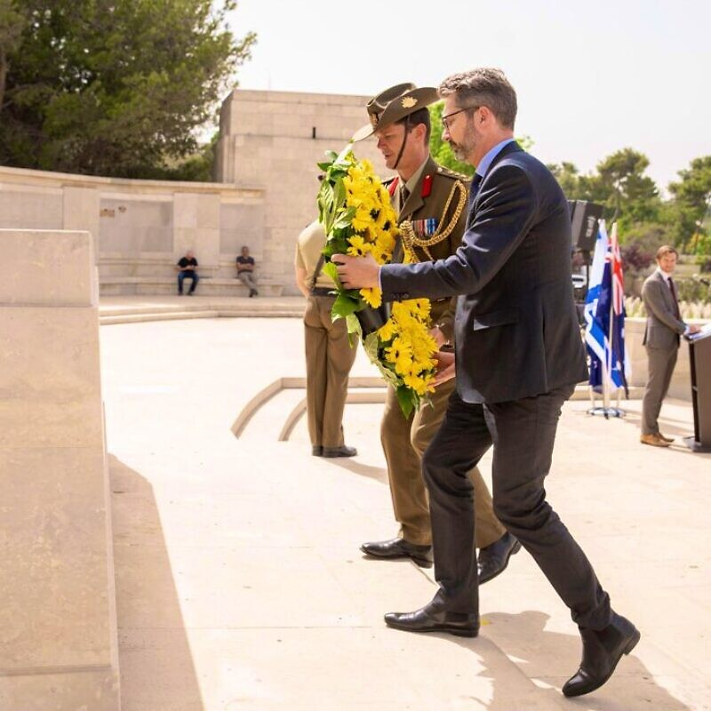 Australia's Ambassador to the Israel Chris Cannan lays a wreath at the British war cemetery in Jerusalem on ANZAC Day in 2019, where Australian soldiers who took part in World War I are buried. Source: Chris Cannan via Twitter.