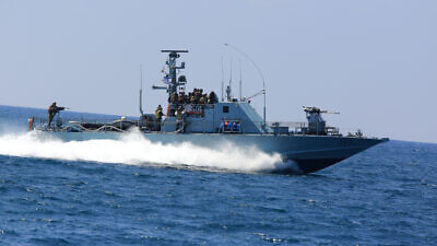 "An Israeli Navy boat, off the coast of Gaza, during Operation ""Protective Edge"" on July 28, 2014. Photo by Edi Israel/Flash90."