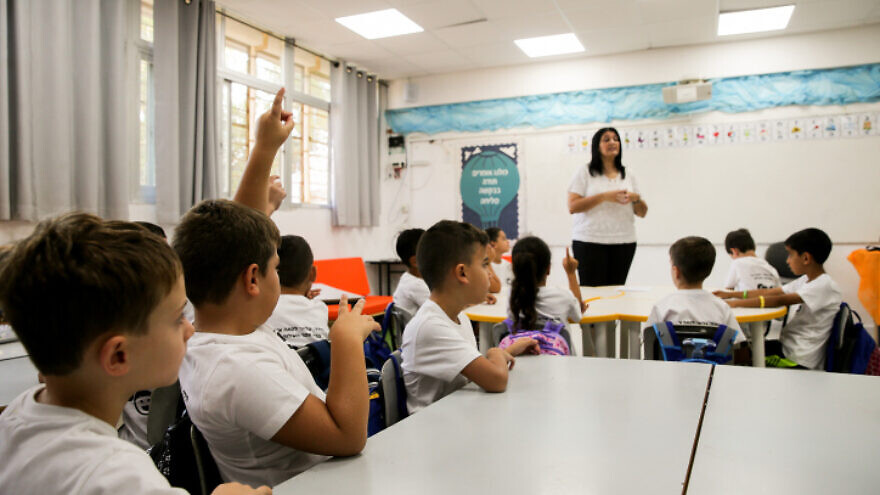 First-grade students sit in a classroom on their first day of school at Hashalom elementary school in Mevaseret Zion, a suburb of Jerusalem. on Sept. 1, 2019. Photo by Flash90.