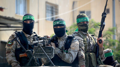 "Palestinian fighters from Izz ad-Din al-Qassam Brigades attend a reception for ""Abdel Halim Badawi,"" who served 18 years in Israeli prison, in Rafah in the southern Gaza Strip, on Oct. 17, 2019. Photo by Abed Rahim Khatib/Flash90."