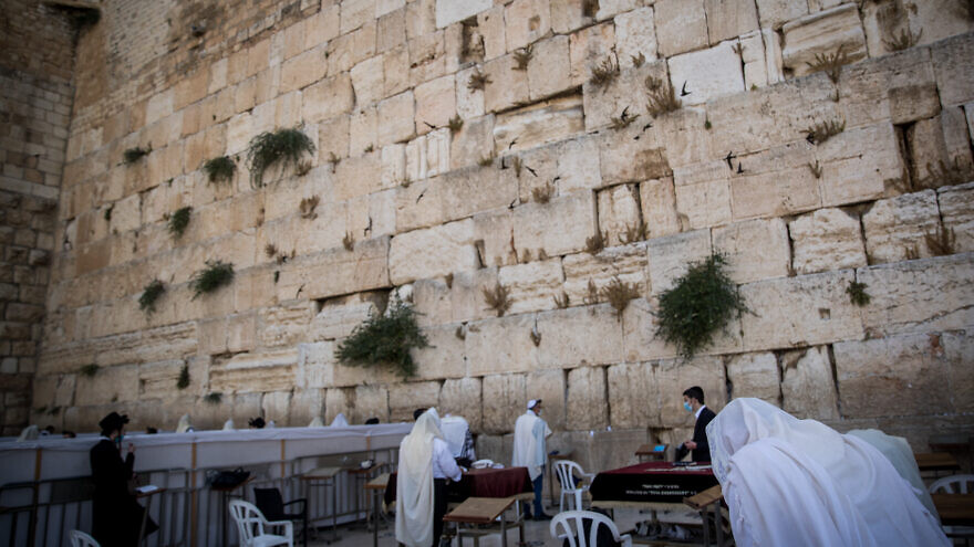 Jewish men pray at the Kotel, the Western Wall, in the Old City of Jerusalem on June 21, 2020. Photo by Yonatan Sindel/Flash90.