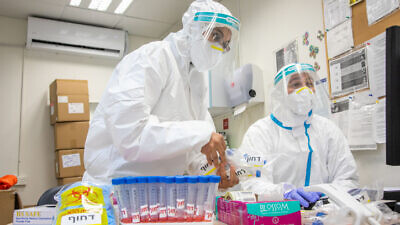 Israeli health-care workers test samples for coronavirus in Modi'in, on July 7, 2020. Photo by Yossi Aloni/Flash90.