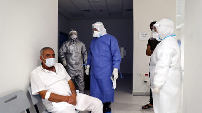 Medical staff treat a patient in the coronavirus section at the Dura hospital near Hebron, July 14, 2020. Photo by Wisam Hashlamoun/Flash90.