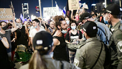 Israelis protest against Israeli Public Security Minister Amir Ohana in Tel Aviv on July 28, 2020. Photo by Tomer Neuberg/Flash90.