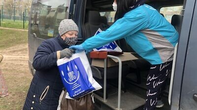 Staff and volunteers with the Joint Distribution Committee (JDC) distribute food packages to the Jewish community in Kishinev, Moldova. Credit: Courtesy.