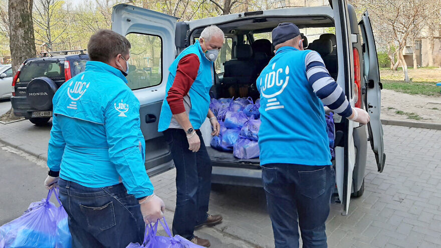 Staff and volunteers with the American Jewish Joint Distribution Committee (JDC) distribute food packages to the Jewish community in Kishinev, Moldova, 2020. Credit: Courtesy.
