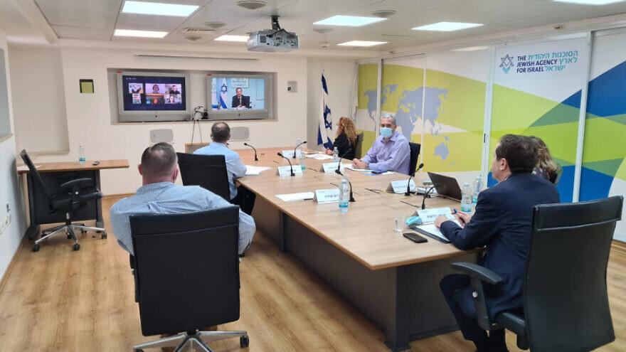 Jewish Agency for Israel Chairman Isaac Herzog (right screen) addresses Diaspora leaders (left screen) and staff on July 8, 2020. Credit: Jewish Agency for Israel.