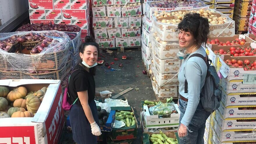 Staff from JLM Food Rescuers take and use food from the Givat Shaul food market that would otherwise be thrown out. Credit: Courtesy.