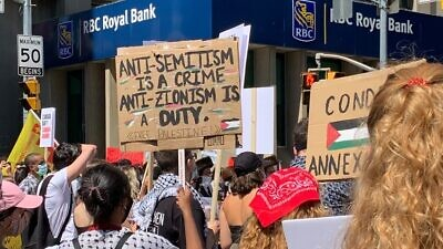 "Pro-Palestinian activists, supported by a wide array of leftist and Marxist organizations, including Antifa and elements associated with Black Lives Matter, hold a ""Day of Rage"" protest against Israel's planned extension of its sovereignty to the Jordan Valley and parts of Judea and Samaria, outside the Israeli consulate in Toronto. Credit: TheJ.ca."