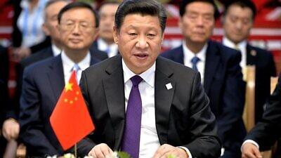 Chinese President Xi Jinping meets with Russian President Vladimir Putin and President of Mongolia Tsakhiagiin Elbegdorj at the 2015 BRICS summit in Ufa, Russia, on July 9, 2015. Credit: Russian Presidential Press Office via Wikimedia Commons.
