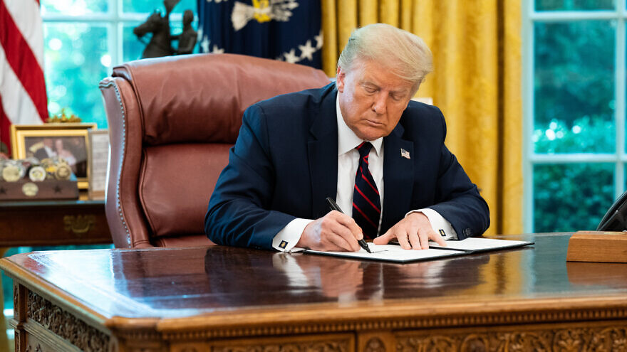 U.S. President Donald Trump signs a Presidential Memorandum on Excluding Illegal Aliens From the Apportionment Base Following the 2020 Census on July 21, 2020, in the Oval Office of the White House. Credit: Joyce N. Boghosian/The White House.