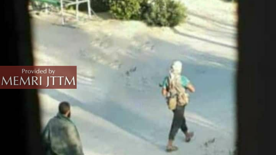 ISIS gunmen walking in Rabi'a village after an attempted terror attack on July 21, 2020. Credit: MEMRI.
