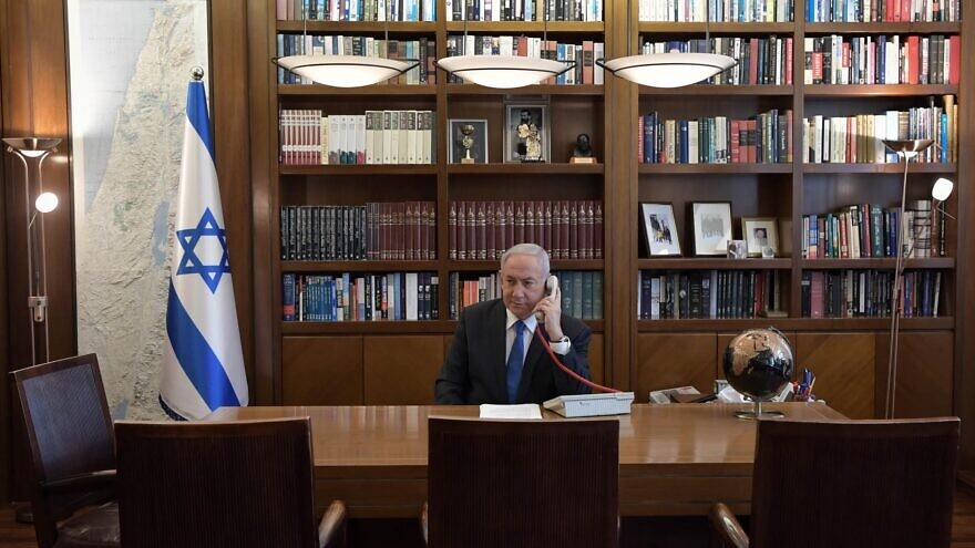 Israeli Prime Minister Benjamin Netanyahu on the phone with U.S. President Donald Trump and UAE Sheikh Mohammed bin Zayed Al Nahyan on Aug. 13, 2020. Credit: Kobi Gideon/GPO.