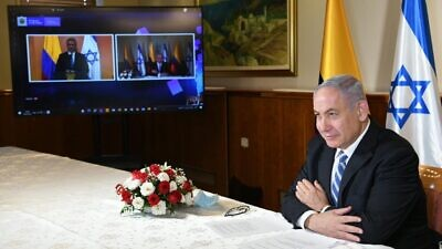 Israeli Prime Minister Benjamin Netanyahu holds a video conference with Colombian President Ivan Duque to finalize a free-trade agreement, on Monday, Aug. 10, 2020. Source: Facebook/Benjamin Netanyahu.