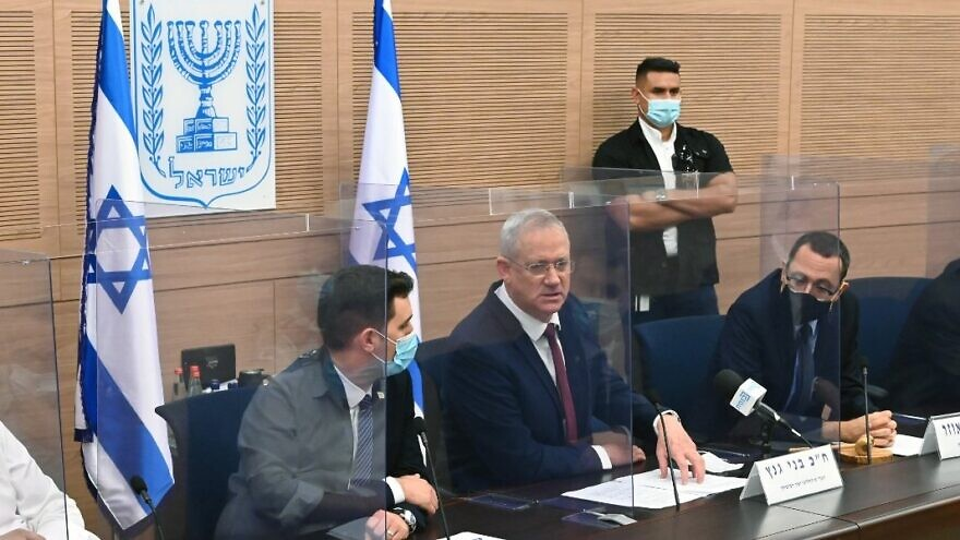 Israeli Defense Minister Benny Gantz addresses the Knesset Foreign Affairs and Defense Committee, chaired by M.K. Zvi Hauser (seated, right) on Monday, Aug. 10, 2020. Source: Twitter/Benny Gantz.