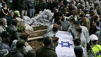 IDF soldiers carry the flag-draped coffin of their comrade, Maj. Eliraz Peretz, during his funeral at the Mount Herzl military cemetery in Jerusalem March 28, 2010. Photo by Abir Sultan/Flash 90.