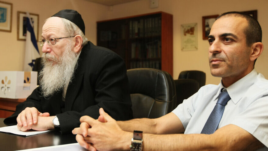 Then-Deputy Health Minister Yaakov Litzman (left) and Health Ministry Director-General Ronni Gamzu attend a press conference at the Health Ministry in Jerusalem on Aug. 7, 2011. Photo by Kobi Gideon/Flash90.