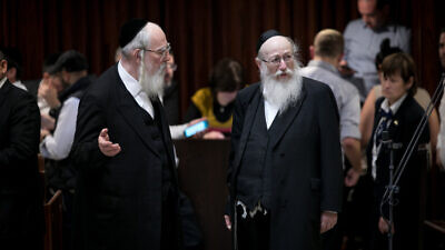 United Torah Judaism Knesset members Yaakov Litzman and Yisrael Eichler during a plenum session in the Israeli parliament on March 12, 2018. Photo by Miriam Alster/Flash90.