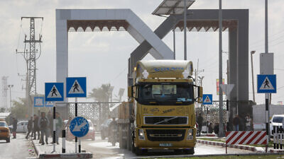 Trucks loaded with goods enter Gaza from the Kerem Shalom crossing in Rafah in the southern Gaza Strip, on Feb. 17, 2019. Photo by Abed Rahim Khatib/Flash90.