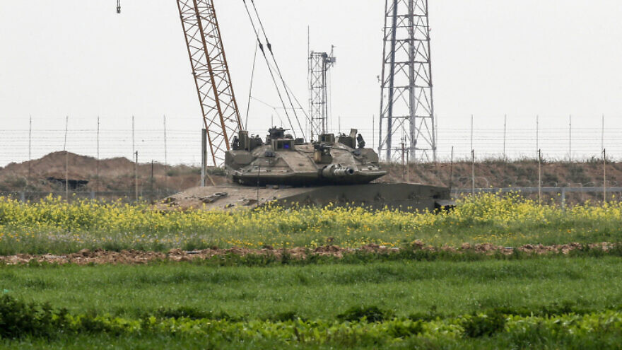 An Israeli Merkava tank seen on the Israeli-Gaza border after Israeli forces killed Jihad Islamic militants while trying to place a bomb along the boder with Israel, east of Rafah, in the southern Gaza Strip, Feb. 23, 2020. Photo by Fadi Fahd/Flash90.
