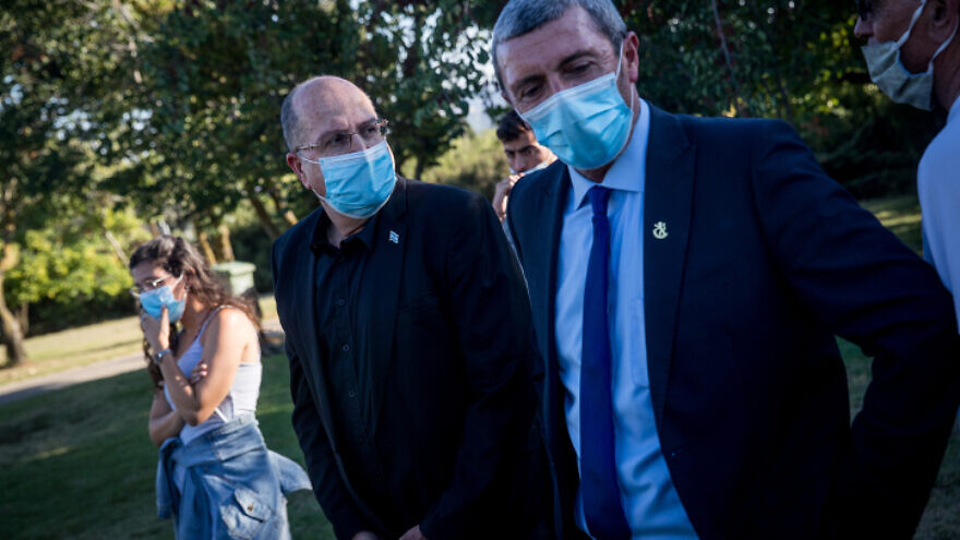 Jerusalem Affairs and Heritage Minister Rafi Peretz (right) and Knesset member Moshe Ya'alon at a protest outside the Knesset, calling for the release of the remains of IDF soldiers Oron Shaul and Hadar Goldin from Hamas captivity. July 1, 2020. Photo by Yonatan Sindel/Flash90.