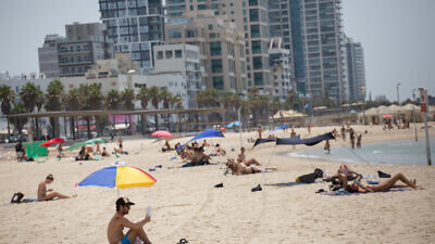 Israelis enjoy the beach on a hot summer day in Tel Aviv on July 28, 2020. Photo by Miriam Alster/Flash90.