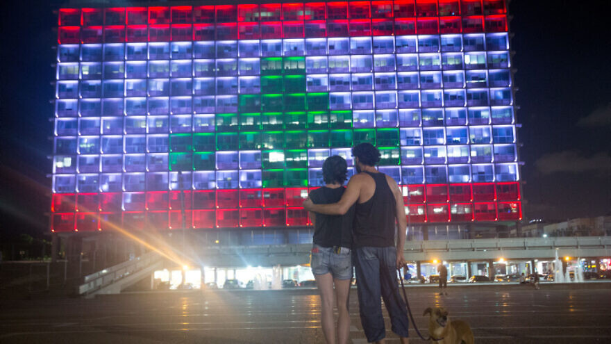 The Tel Aviv Municipality on Rabin Square features the Lebanese flag in solidarity with its northern neighbor, Aug. 5, 2020. Photo by Miriam Alster/Flash90.
