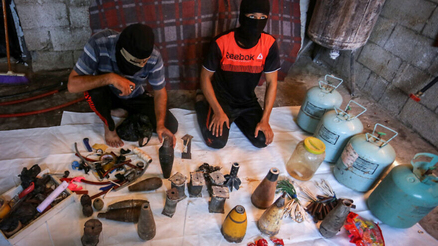 Palestinians prepare explosives and flammable materials to be attached to balloons and launched into Israel from the Gaza Strip, Aug. 8, 2020. Photo by Abed Rahim Khatib/Flash90.