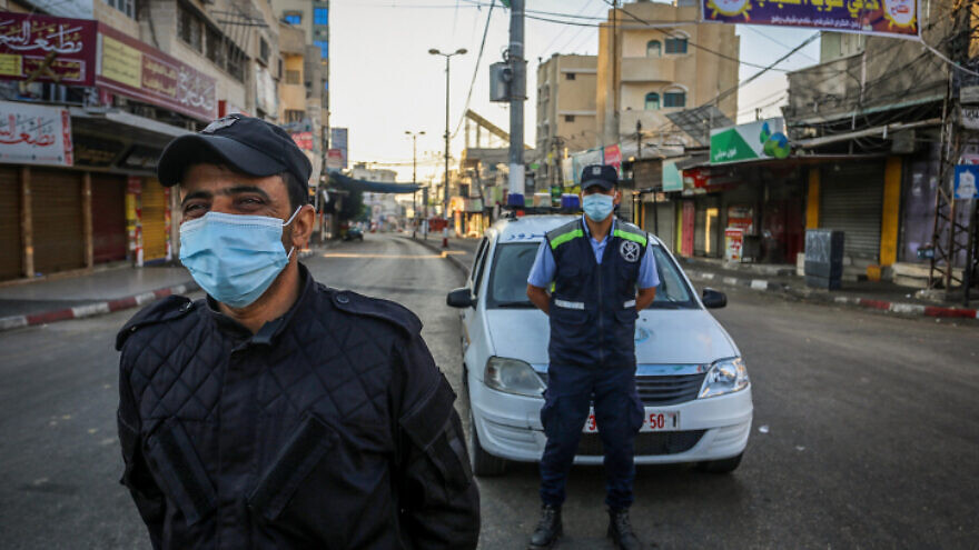 Members of the Palestinian security forces enforce a coronavirus lockdown in Rafah, in the southern Gaza Strip, on Aug. 25, 2020. Photo by Abed Rahim Khatib/Flash90.