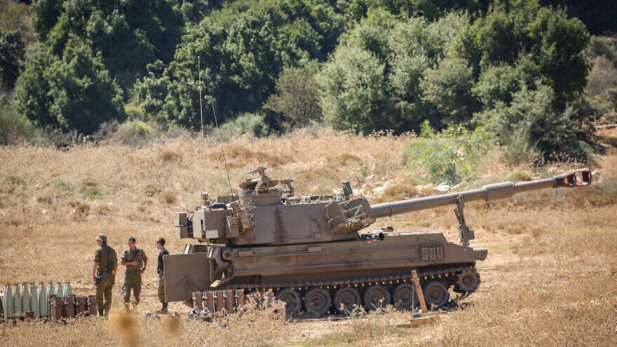 Israeli soldiers stand near artillery units deployed near the Lebanese border northern Israel on August 26, 2020. Photo by David Cohen/Flash90.