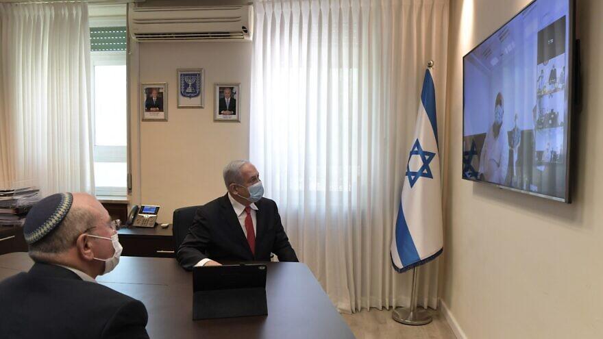 Israeli Prime Minister Benjamin Netanyahu in a videoconference with Israel Institute for Biological Research director-general Professor Shmuel Shapira. Credit: Kobi Gideon/GPO.