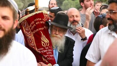 Rabbi Adin Even-Israel Steinsaltz (holding Torah scroll). Credit: Courtesy of the Steinsaltz Center.
