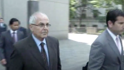 Peter Madoff, brother of disgraced financier Bernie Madoff, walks out of a federal courthouse in New York on June 29, 2012, after pleading guilty to charges of conspiracy and fabricating investment records as part of his brother's Ponzi scheme. He was released from federal custody on Aug. 13, 2020. Source: Screenshot.
