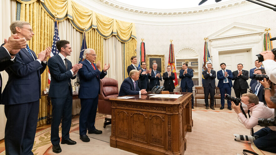 U.S. President Donald Trump, joined by White House senior advisers, receives applause after delivering a statement announcing the agreement of full normalization of relations between Israel and the United Arab Emirates on Aug. 13, 2020. Credit: Joyce N. Boghosian/The White House.
