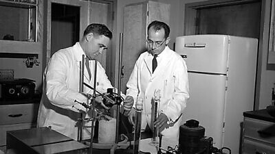 Dr. Jonas Salk with Percival (Val) Bazeley, one of the polio team's senior scientists circa 1954/1955. Credit: University of Pittsburgh Historic Photographs.
