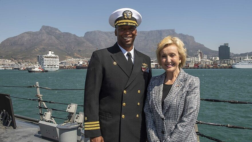 Lana Marks, U.S. ambassador to the Republic of South Africa (right) and Cmdr. Christopher Carroll, commanding officer of the Arleigh Burke-class guided-missile destroyer USS Carney, pose for a photo following a luncheon aboard the Carney during a scheduled visit to Cape Town, South Africa, March 16, 2020. U.S. Navy photo by Mass Communication Specialist 1st Class Fred Gray IV/Released.