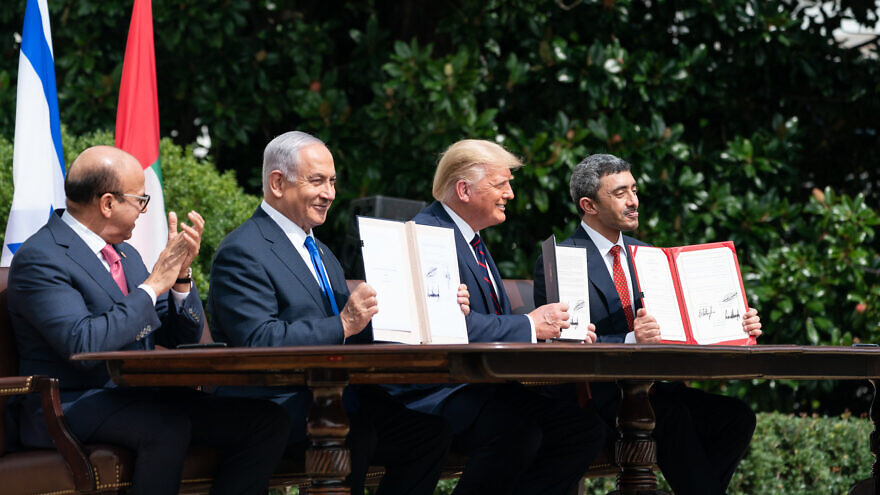 Israeli Prime Minister Benjamin Netanyahu, flanked by U.S. President Donald Trump, Bahraini Foreign Minister Abdullatif bin Rashid Al-Zayani and UAE Foreign Minister Abdullah bin Zayed Al Nahyani, at the signing of the Abraham Accords on the South Lawn of the White House, Sept. 15, 2020, Credit: White House/Joyce N. Boghosian.
