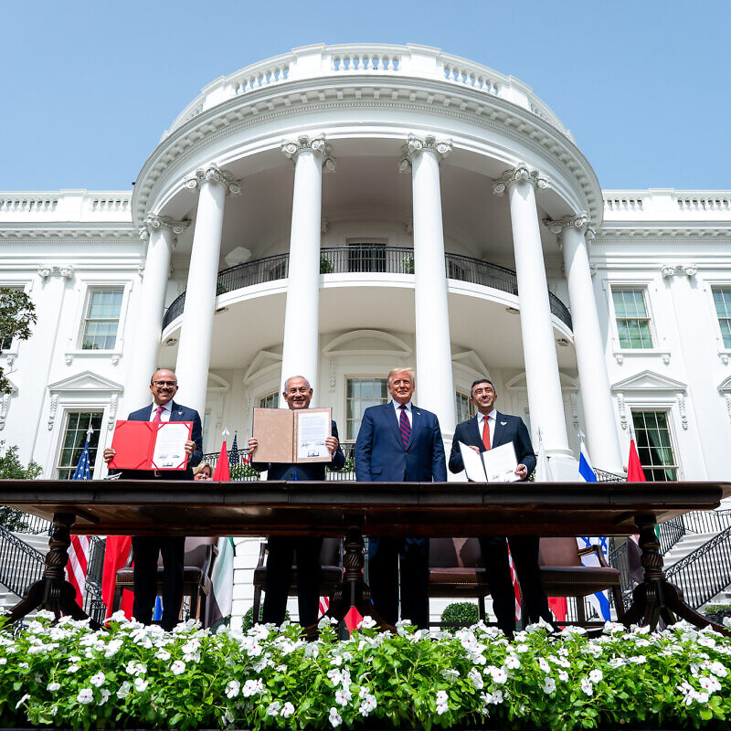 U.S. President Donald Trump, Minister of Foreign Affairs of Bahrain Abdullatif bin Rashid Al-Zayani, Israeli Prime Minister Benjamin Netanyahu and Minister of Foreign Affairs for the United Arab Emirates Abdullah bin Zayed Al Nahyani sign the Abraham Accords on the South Lawn of the White House, Sept. 15, 2020. Credit: Official White House Photo by Tia Dufour.