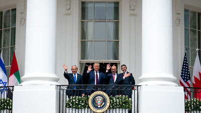 U.S. President Donald Trump, Bahraini Foreign Minister Abdullatif bin Rashid Al-Zayani, Israeli Prime Minister Benjamin Netanyahu and UAE Foreign Minister Abdullah bin Zayed Al Nahyani wave from the Blue Room balcony during the Abraham Accords signing on Sept. 15, 2020. Credit: White House/Tia Dufour.