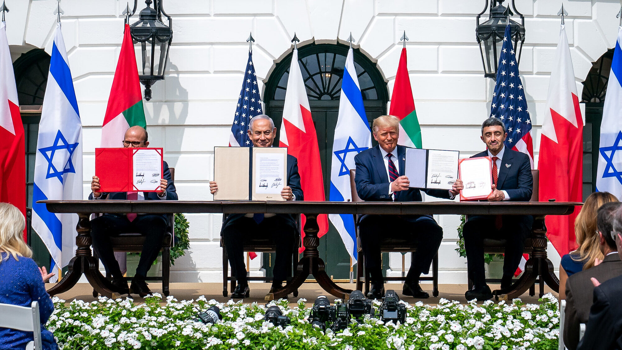 U.S. President Donald Trump, Bahraini Foreign Minister Abdullatif bin Rashid Al-Zayani, Israeli Prime Minister Benjamin Netanyahu and UAE Foreign Minister Abdullah bin Zayed Al Nahyani sign the Abraham Accords on the South Lawn of the White House, Sept. 15, 2020. Credit: White House/Tia Dufour.
