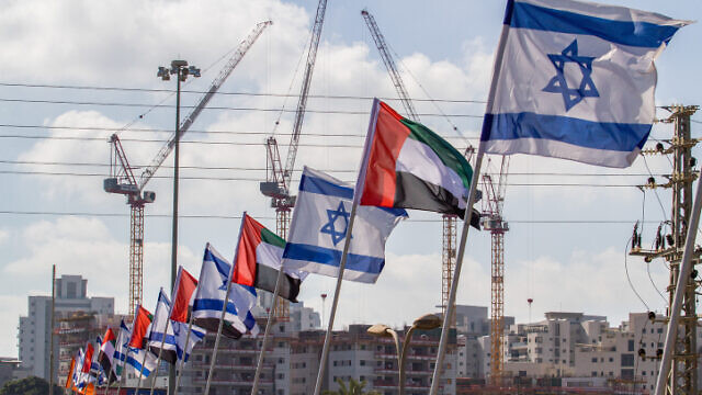 Israeli and United Arab Emirates flags on the side of a road in the city of Netanya, Aug. 16, 2020. Photo by Flash90.